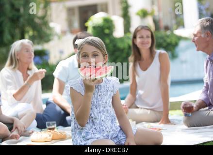 Girl eating watermelon at picnic - Stock Photo