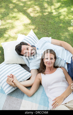 Couple relaxing on picnic blanket - Stock Photo