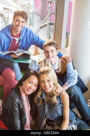 University students smiling in lounge - Stock Photo