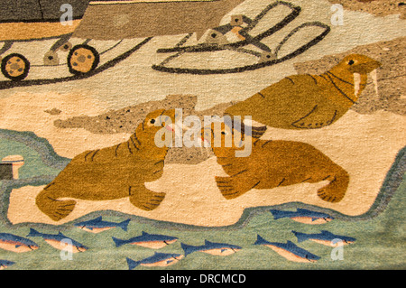 Tapestry showing the life of the Inuit Eskimos, Baffin Island, Nunavut, Canada - Stock Photo