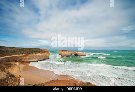 Famous rocks London Bridge in the rain,Great Ocean Road, Australia - Stock Photo