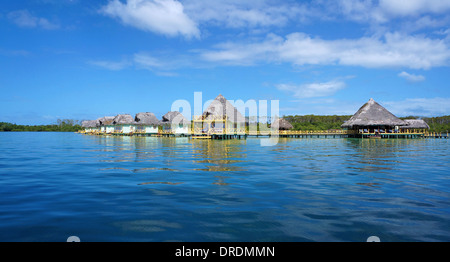 Panoramic view over a tropical resort with thatched bungalows over the sea, Colon island, Caribbean sea, Bocas del - Stock Photo