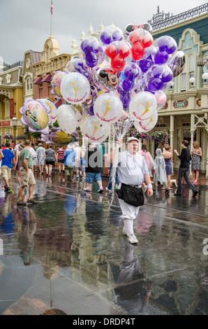 Balloon Salesman at Magic Kingdom, Walt Disney World in Orlando, Florida - Stock Photo