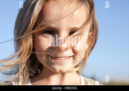 Young girl with hair blowing in her face - Stock Photo