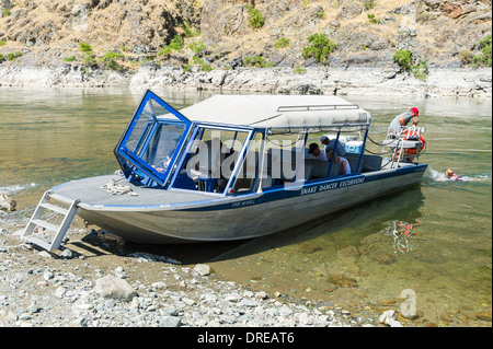 Jet Boat in Hells Canyon, on the Snake River, forming the border between Idaho and Oregon, USA. - Stock Photo