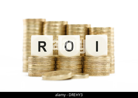 ROI (Return on Investment) Coin Stacks Isolated White Background - Stock Photo