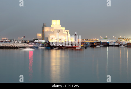 Museum of Islamic Art in Doha illuminated at dusk. Qatar, Middle East - Stock Photo