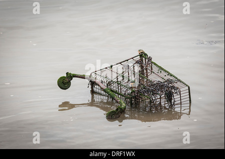 A shopping trolley thrown into the River Thames. - Stock Photo