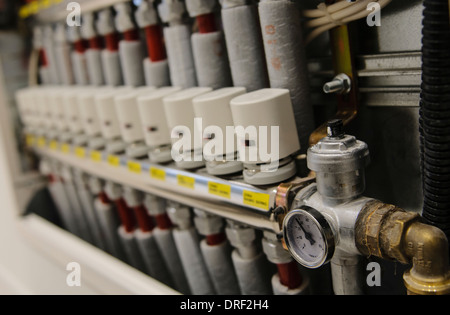 Insulated pipes and valves in a centralized heating and air conditioning system