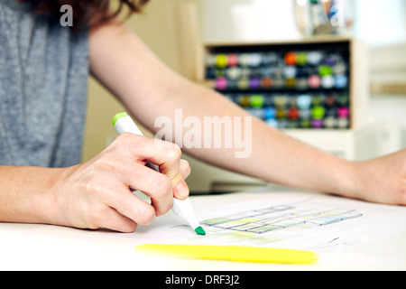 Woman works at desk, making notes, Munich, Bavaria, Germany - Stock Photo