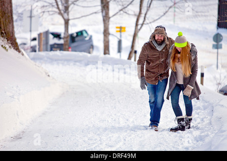 Couple Walking In Snow, Spitzingsee, Bavaria, Germany - Stock Photo