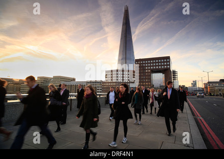 Commuters on London Bridge, morning rush hour, London - Stock Photo