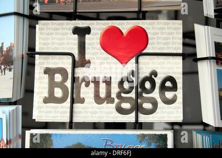 A 'I love Brugge' postcard on a rotating shop postcard rack in historic Bruges (Brugge), West Flanders, Belgium. - Stock Photo