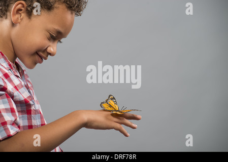Utah USA child with butterfly on hand keeping very still - Stock Photo