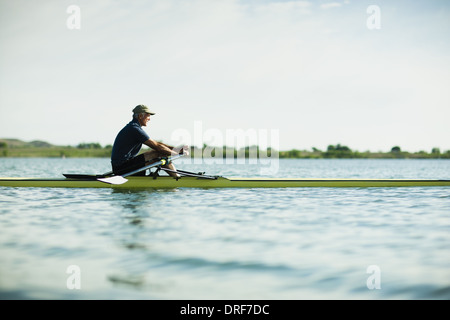 Colorado USA middle-aged man in rowing boat on the water - Stock Photo