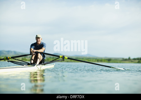 Colorado USA middle-aged man rowing single scull rowing boat - Stock Photo
