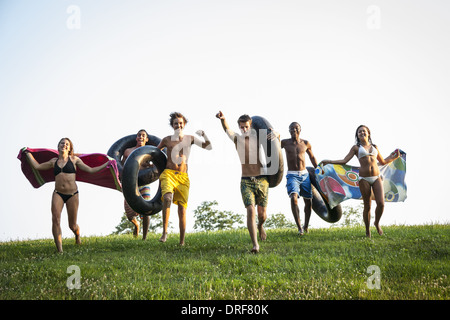 Maryland USA teenagers boys and girls running across the grass - Stock Photo