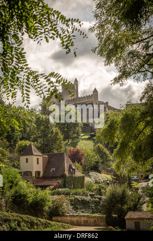 Beynac-et-Cazenac, Dordogne, France, Europe. View of the stunning Château de Beynac through the trees. - Stock Photo