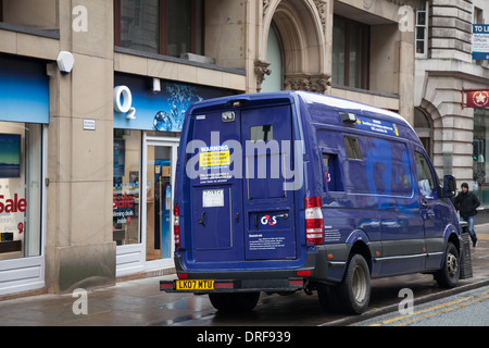 G4S cash in transit van with security guard entering ...
