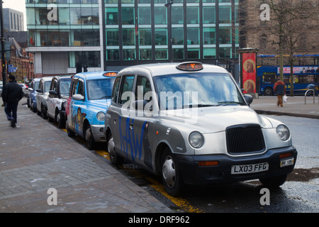 Colourful Piccadilly Taxis _Hackney Cabs, Private Hire Vehicles for hire_ Taxis in Manchester City Centre, UK, Europe, - Stock Photo