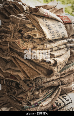 New York state USA pile of empty stamped hessian sacks bundled reuse - Stock Photo