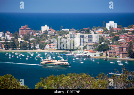 Manly View from Dobroyd Head with ferry leaving harbour and Tasman Sea Pacific Ocean in distance Sydney NSW Australia - Stock Photo