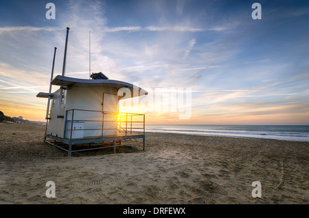 A Lifeguard hut on at sunrise at Durley chine on Bournemouth beach in Dorset - Stock Photo