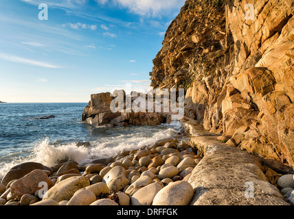 The beach at Porth Nanven Cove near Lands End in Cornwall - Stock Photo
