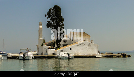 greek orthodox church build on a small ionian island with a tree - Stock Photo