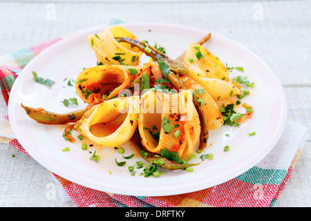 pasta with tomato sauce and green beans, food closeup - Stock Photo