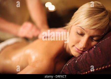 Young woman having a massage, close-up, Dubrovnik, Croatia - Stock Photo