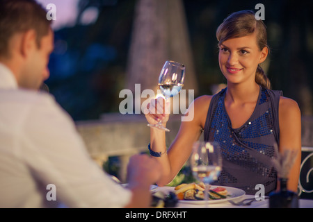 Young couple drinking white wine in restaurant, Dubrovnik, Croatia - Stock Photo
