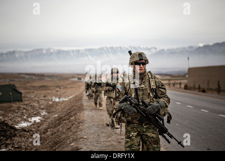 US Army soldiers with the 1st Cavalry Division conduct a patrol January 12, 2014 in Tirin Kot, Uruzgan province, - Stock Photo