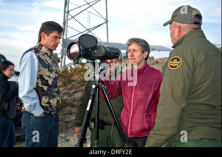 US Interior Secretary Sally Jewell views the Mexican border through high tech binoculars during a tour of southern - Stock Photo