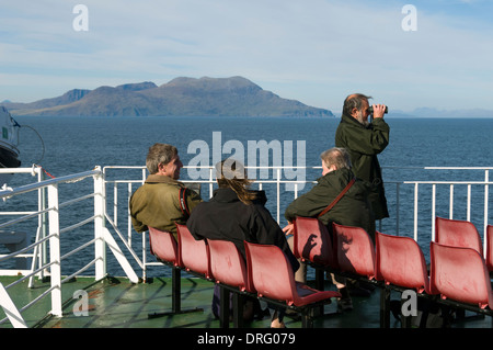 On board the Caledonian MacBrayne's ferry, the 'Lord of the Isles', as it passes the Isle of Rum, Inner Hebrides, - Stock Photo