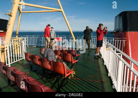 Passengers on board the Caledonian MacBrayne's ferry, the 'Lord of the Isles', bound for the Outer Hebrides, Scotland, - Stock Photo