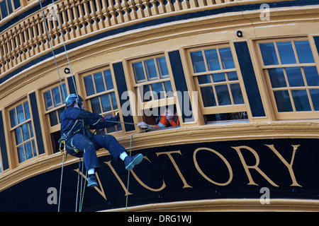 Conservation and maintenance of HMS Victory at Portsmouth Historic Dockyard in January - Stock Photo