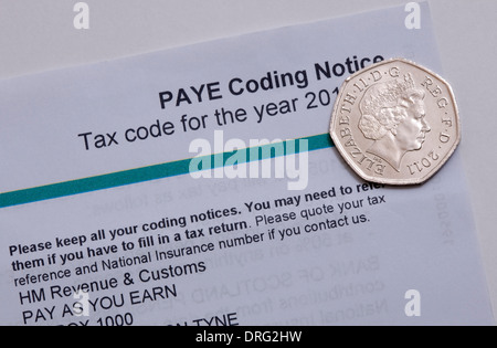 50p fifty pence coin and Paye income tax form - Stock Photo