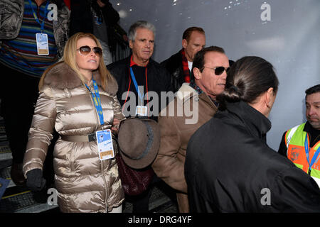 Kitzbuehel, Austria. 25th Jan, 2014. Former US governor and Hollywood actor Arnold Schwarzenegger and his girlfriend - Stock Photo