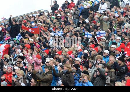 Kitzbuehel, Austria. 25th Jan, 2014. Fans watch the annual Austrian downhill ski race Hahnenkamm race in Kitzbuehel, - Stock Photo