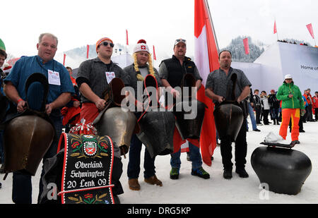 Kitzbuehel, Austria. 25th Jan, 2014. Fans from Switzerland pose cow bells during the annual Austrian downhill ski - Stock Photo