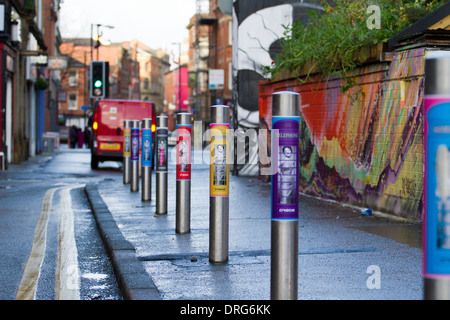 Telephone_Stainless steel posts, pedestrian barriers and poster advertising in Stevenson Square, Northern Quarter, - Stock Photo
