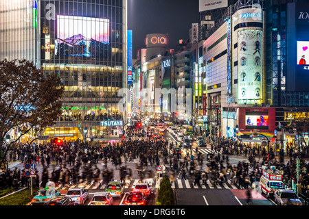 TOKYO, JAPAN - DECEMBER 15, 2012: Pedestrians cross at Shibuya Crossing. The intersection is known as the busiest - Stock Photo