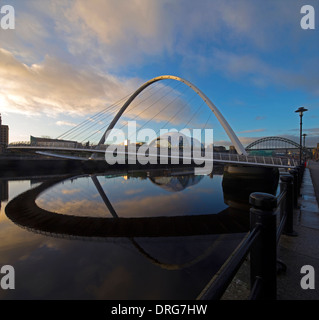 A view at dawn of The Gateshead Millennium Bridge on the River Tyne from Newcastle looking towards the Tyne Bridge - Stock Photo