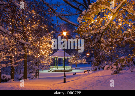 The Bandstand at Hexham in Winter snow & floodlit at dusk, Northumberland - Stock Photo