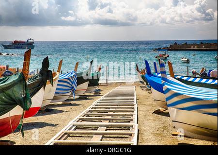 Row of Traditional Boats on the Shore, Monterosso Al Mare, Cinque Terre, Liguria, Italy - Stock Photo