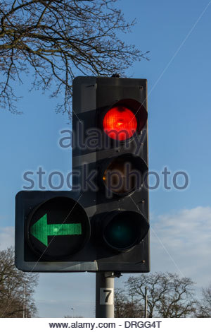 ... Traffic Light Showing A Red Stop Ahead Plus A Left Green Filter   Stock  Photo