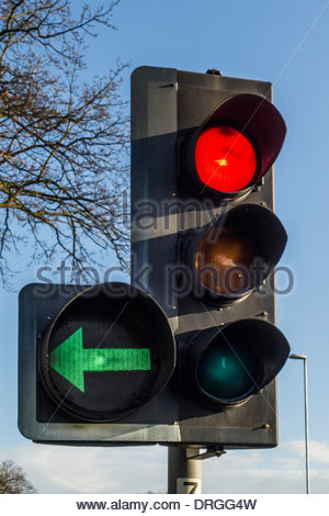 Traffic light showing a red stop ahead plus a left green filter in Cambridge, England, UK - Stock Photo