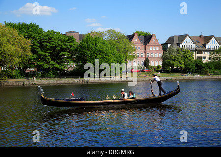 Female gondoliera on lake Alster, Hamburg, Germany, Europe - Stock Photo