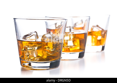 three glass of whiskey on white background - Stock Photo